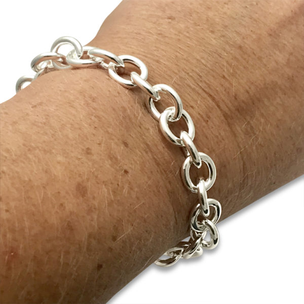 Cable chain bracelet sterling silver solid on wrist, heavy nice feeling and fits many charms of your choice