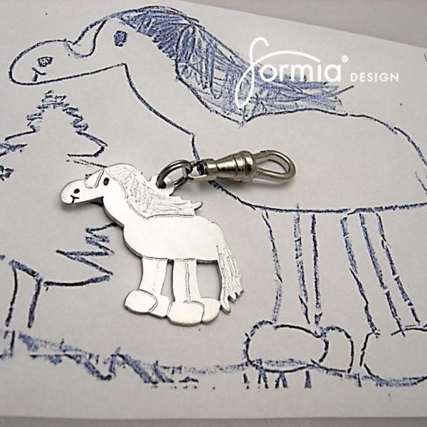 Horse drawing made into a zipper pull in aluminum