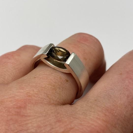 Smokey quartz silver smile ring design shown on finger