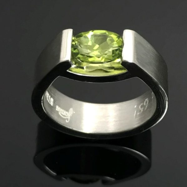 Smile ring with green oval peridot set in sterling silver