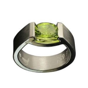 peridot smile ring in sterling silver oval cut gemstone in green