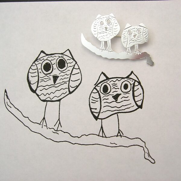 Cute brooch after your own design, drawing on a brooch