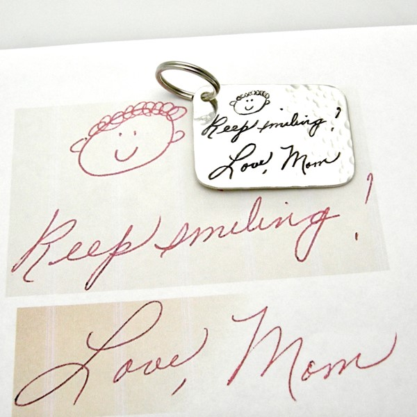 Engraved handwriting on sterling silver key chain along with smiley face