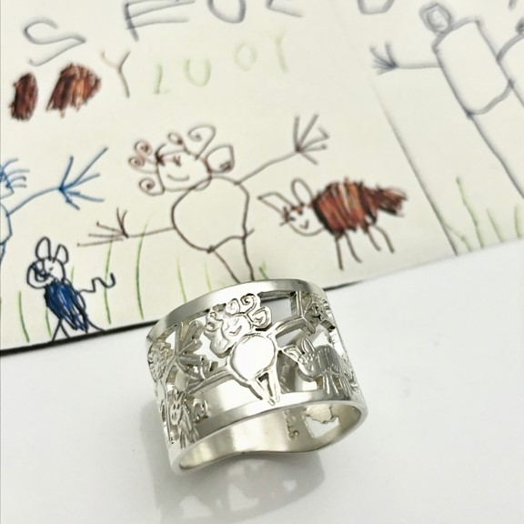 Family drawing cut out in sterling silver for a ring
