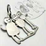 Kids family drawing as titanium keychain
