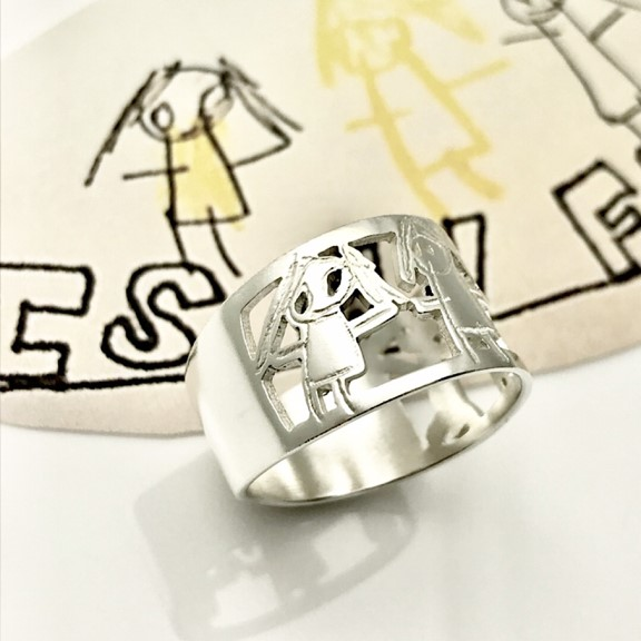 Portrait of mom design on family ring by her child