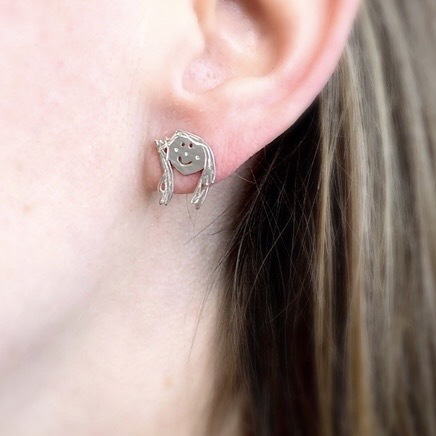 Stud silver earrings with your own design, image shows how it looks on the ear lobe