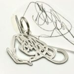 Titanium key chain after toddlers scribble drawing