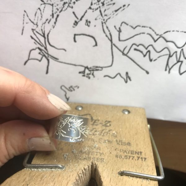 a ring during the process to be handgraved after your own drawing