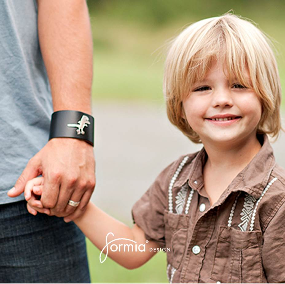 wide leather cuff bracelet on dads arm with boys drawing