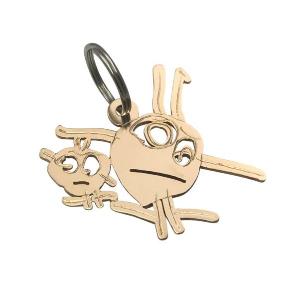 Bronze key chain transformed from drawing of little stick figures