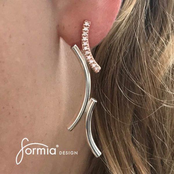 Kurvene diamond earrings on ear simplicity of style and every day use