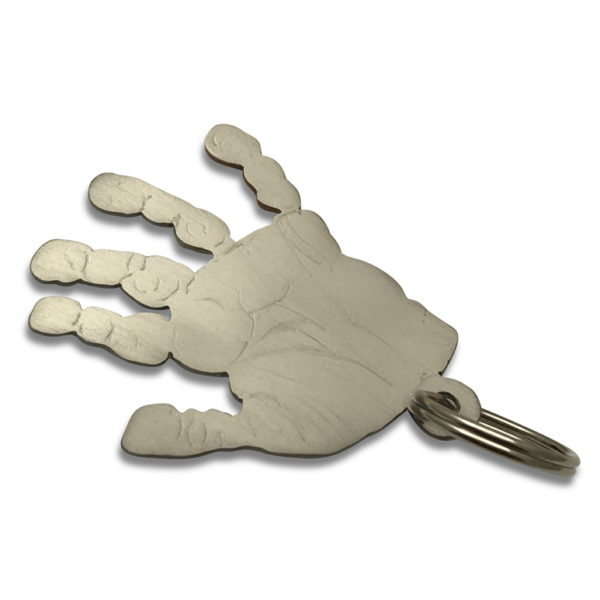 hand print key chain in titanium each single hand carefully cut out and engraved by hand