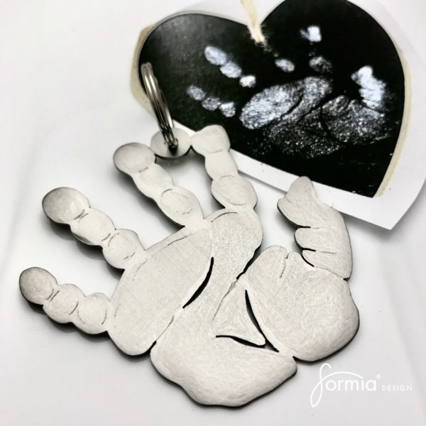 white handprint inside a heart cut out titanium keychain
