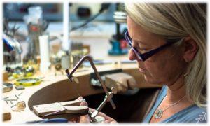 jewelry design by kids Goldsmith Mia van Beek working on custom jewelry at her bench
