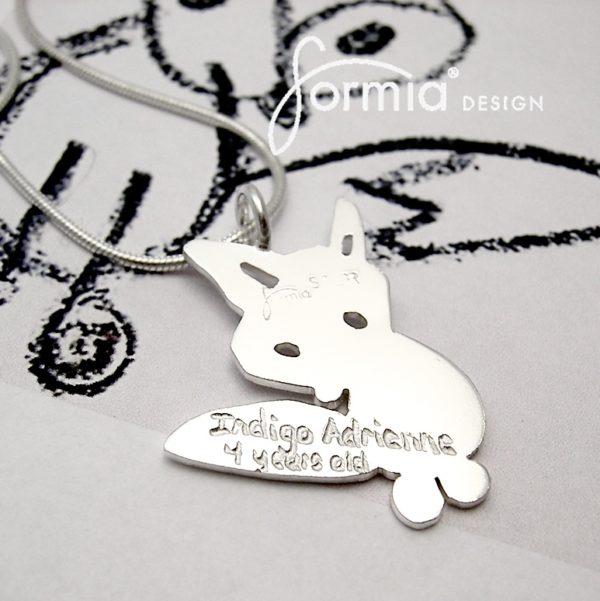 regular font engraving on back of fox pendant
