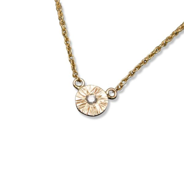 Textured disc pendant necklace with diamond, rope chain is holding this very cute little gem