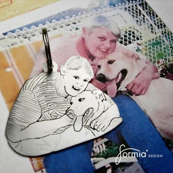 a mans best friend pet photo key chain, woman hugs dog
