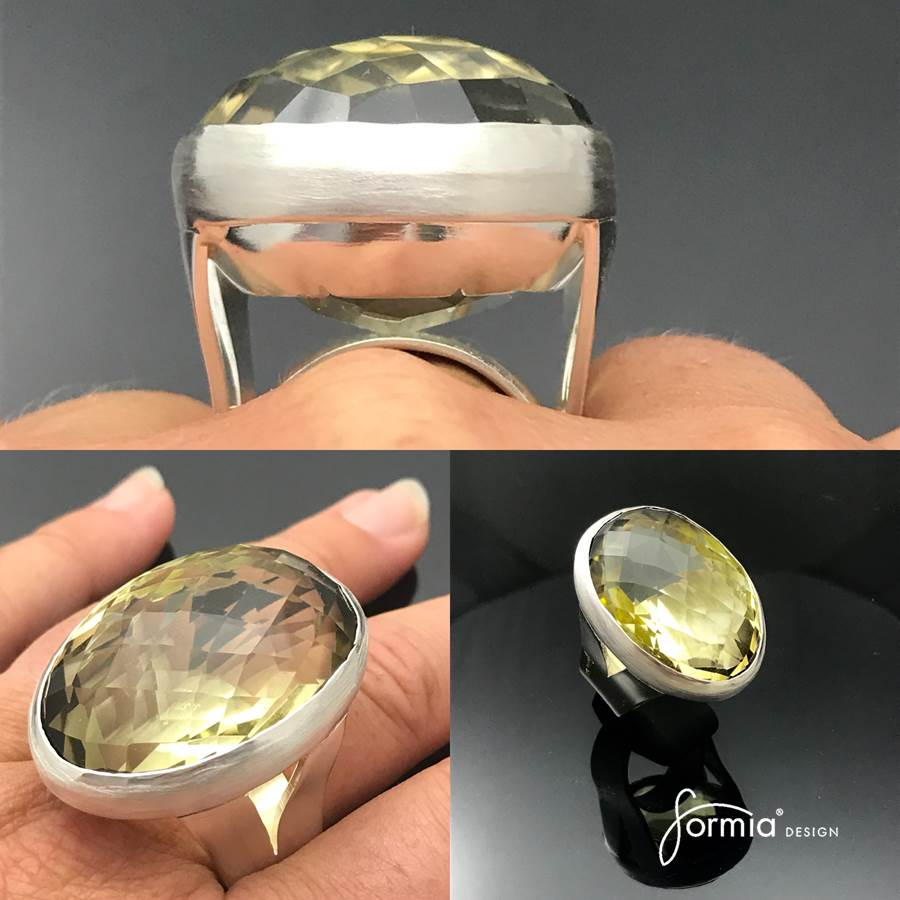 Custom designed jewelry customers large yellow gemstone in silver ring bezel setting