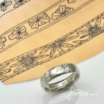 Custom designed ring, stickel engraved wedding band with drawn flowers by the groom