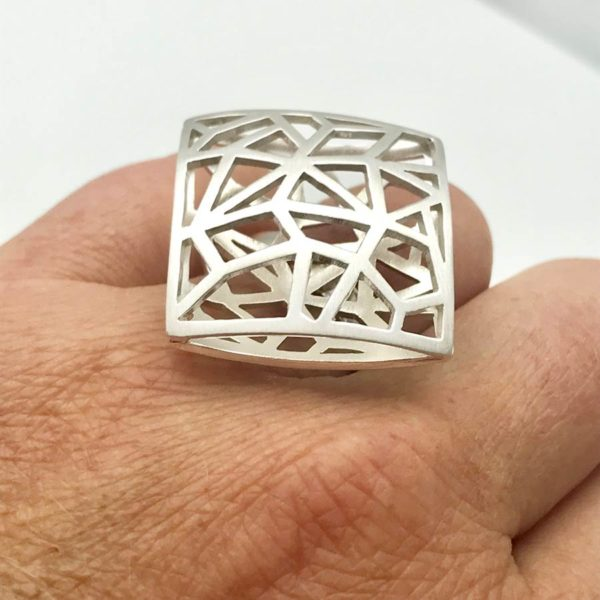 Geometry ring on the hand, attention seking jewelry