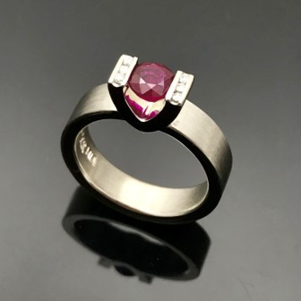 ruby tension set ring with black black ground