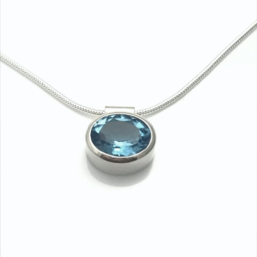 Simplicity for every woman blue topaz in bezel setting