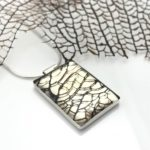 Sea grass fan captured in resin silver necklace