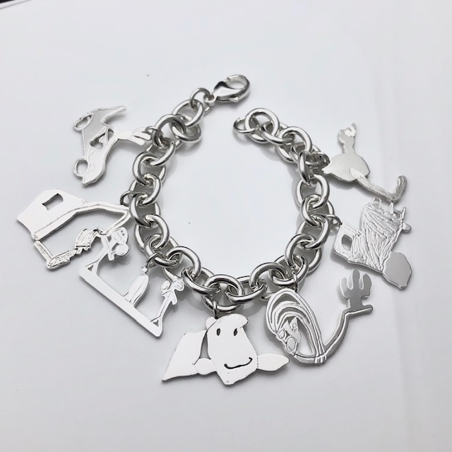 Putting a charm on Mom's every birthday -collect your kids art for charm bracelet