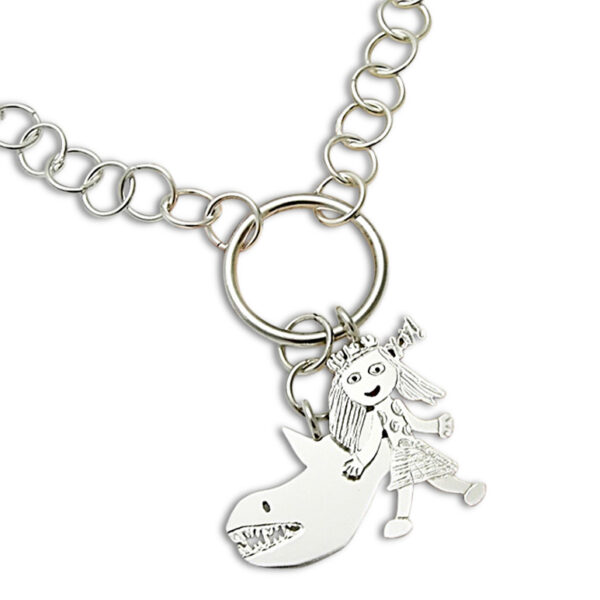 cluster of charms necklace with two charms girl and shark