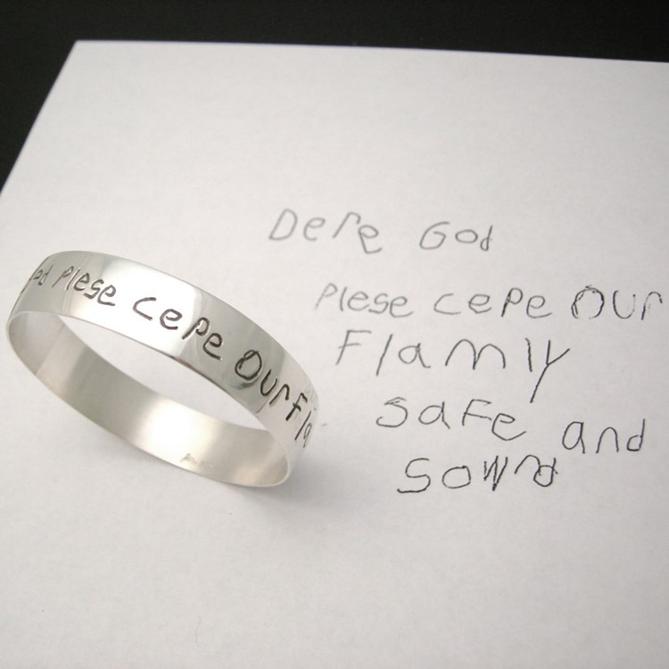 Childs hadwritten prayer engraved on a braclet bangle