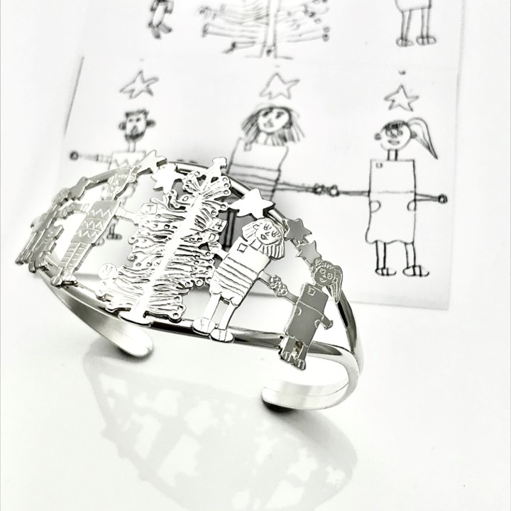 Christmas drawing of family on a bracelet