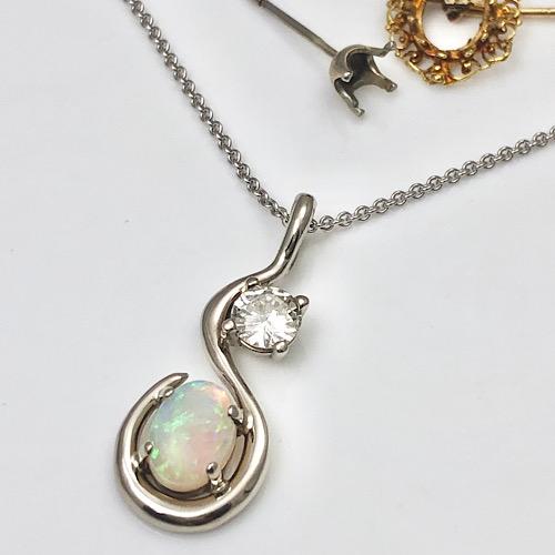Orphaned earrings turned into a pendant