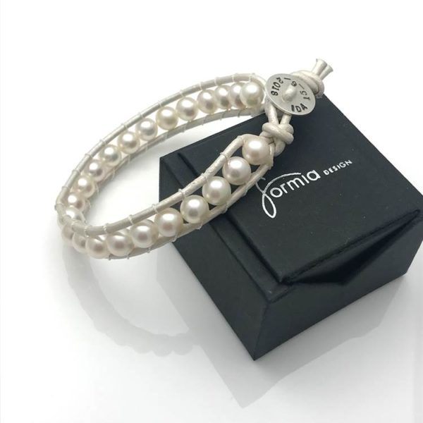 Leather strand with white pearls on bracelet