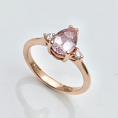 Pink sapphire proposal in rose gold ring