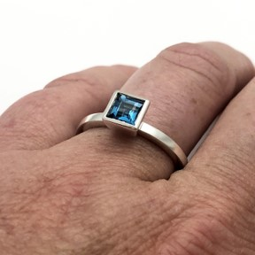 Beautiful Square blue topaz stack ring on the finger