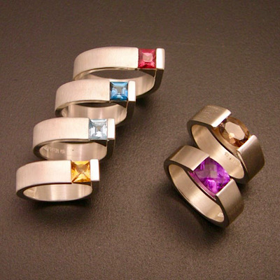 Multi colored gemstones in square edge ring and smile ring