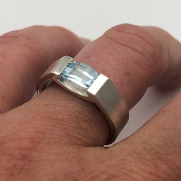 Sky blue topaz smile ring barrel cut stone ring on finger