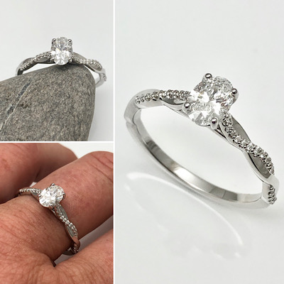 A oval classic ring, engagement ring with ivsl cut diamond and tiny diamond accents