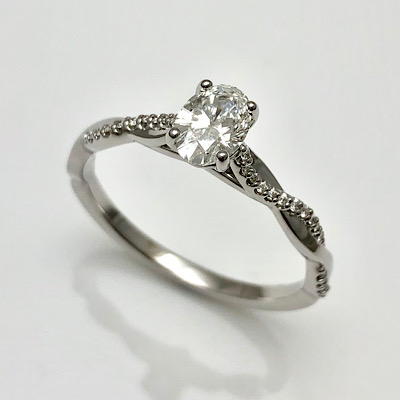 Engagement ring in classic braided style shank and oval cut diamond center