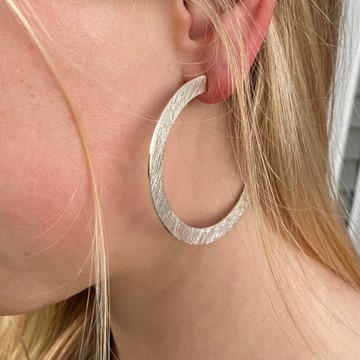 Bold and eye catching hoop earrings in sterling silver