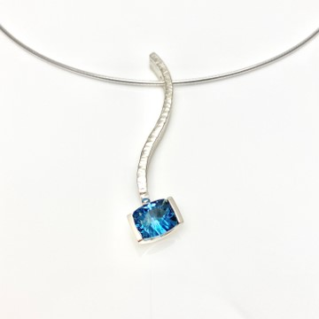 Blue topaz Serpentine pendant, lovely to be worn by it self but also together with other pendants