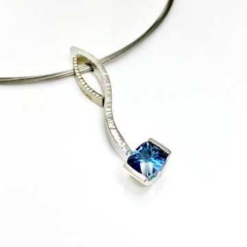 Blue topaz and diamond curve pendants in elegant combo