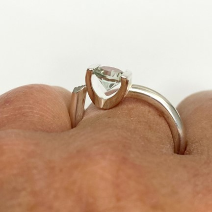 Brave and interesting setting for special cut green quartz in ring
