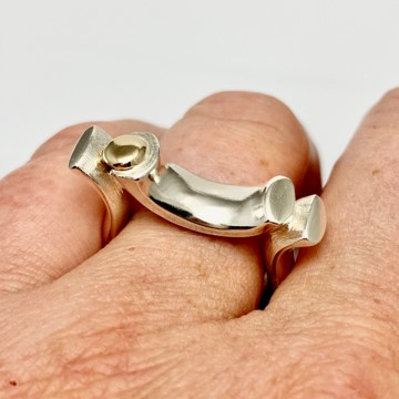 Bridged silver ring on the finger
