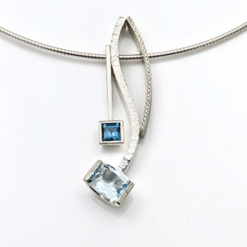 Tones of blue and diamonds in lovely combination of pendants