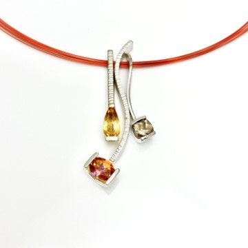 Topaz and quartz gemstones in fall leaf colors, in a modern interchangeable design