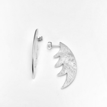 Wing earring for cutting edge earring collection, frosted texture in silver
