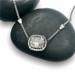 Cushion cut diamond in halo pendant, tapered baugettes on chain, redesigned ring