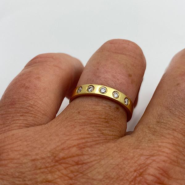 Flush set diamond band on the finger for wedding